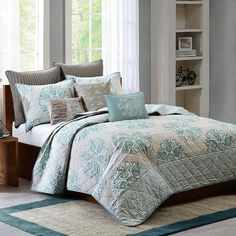 Features:  -Set includes: 1 Coverlet and 2 Shams.  -Pattern: Medallion.  -Machine wash cold, gentle cycle, and separately.  Product Type: -Quilt/Coverlet set.  Style: -Contemporary.  Pattern: -Nature/