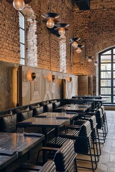 Industrial restaurant setting with exposed bricks and warehouse windows. Kilimanjaro, a luxury restaurant and bar located in a converted brewery, Istanbul. Designed by studio Autoban and featured on www.martynwhitedesigns.com