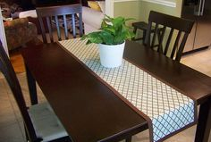 Make your own table runner without having to sew!  All you need is an iron, fabric, hem tape and ribbon!