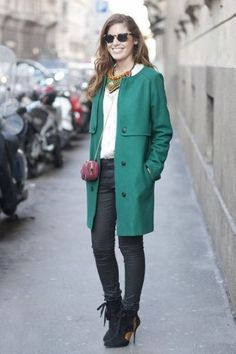 Wear a dark green trenchcoat and black slim jeans for a Sunday lunch with friends. A pair of black suede booties will seamlessly integrate within a variety of outfits.   Shop this look on Lookastic: https://lookastic.com/women/looks/trenchcoat-button-down-blouse-skinny-jeans/14839   — Black Sunglasses  — Green Necklace  — White Button Down Blouse  — Dark Green Trenchcoat  — Burgundy Leather Crossbody Bag  — Black Skinny Jeans  — Black Suede Ankle Boots
