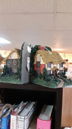 Cottage bookends. Booth  238.