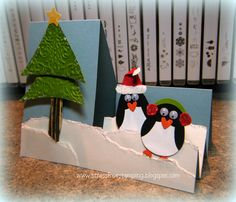 Stamping without ink challenge.  Really cute little penguins on a stair-step card by Shana Gaff