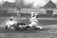 Tiger Ty Cobb steals home in the first inning of the Detroit-Cleveland game in April 1912 at Navin Field. (William Kuenzel / The Detroit News)