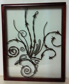 This custom window features a beautiful design that is in an original antique frame. It is Meticulously crafted piece by piece with aged barb wire. A beautiful design with flourish and character. Animals, Birds, Names, Logos, Instruments, States, People, Trees, Signs. Pet passed away and you still have a picture? yeh man no problem! send it and I'll bring it back to life with barbed wire. If you want that old barn wood type deal look, I'm telling you I got it. Name it I'll Frame it! yeh man.