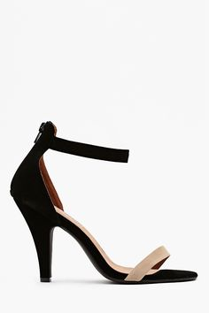 Super chic black suede pumps featuring a nude toe strap and tapered heel. Zip closure at back, leather lining. Looks perfect paired with a mesh tee and leather mini! By Jeffrey Campbell.
