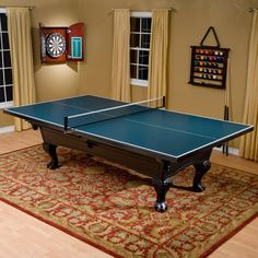 Have to have it. Butterfly 5/8 in. Table Tennis Conversion Top with 2 Player Set - $384.99 @hayneedle.com