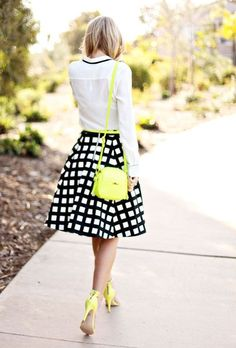 Electric neon is a big trend this season, but the key is to keep it in the details. Instead of opting for a head-to-toe, shockingly bright ensemble, find a great pair of hot pink pumps or a neon yellow shoulder bag. These will draw the eye and keep your look classy with an air of whimsy.  Last Tip: Black and white is the best base for neon details, they really make the electrifying hue pop!