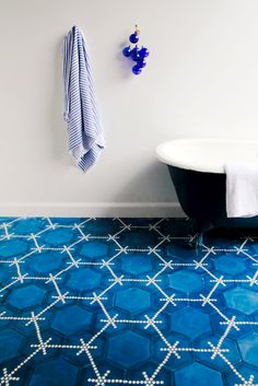 Blue tile in white bathroom