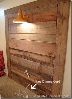 wood headboard with barn light