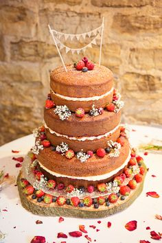 Three tier naked Victoria sponge cake decorated with fresh fruit & flowers | Photography http://www.rachaeledwardsphotography.co.uk/