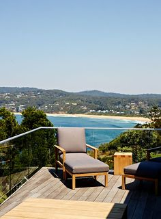 Burleigh easy chair & side table by Eco Outdoor, view to Copacabana beach below. Photo - Sean Fennessy, production – Lucy Feagins / The Des...