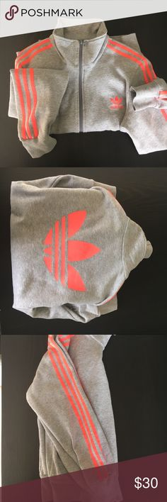 Adidas zip up sweatshirt Adidas zip up sweatshirt in grey with hot pink adidas strips down the arm. Adidas logo large on the back. No stains or rips. adidas Other