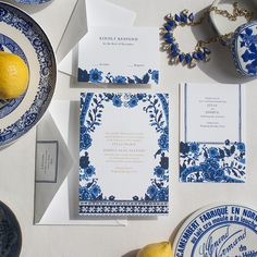 This watercolor and foil wedding invitation suite is inspired by a mix of cultures in our favorite classic, bold color palette: the cobalt blue and crisp white Asian patterns of our mothers' Blue Willow porcelain china, the vibrant shades of Mykonos, and classic floral Delftware.