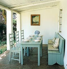 Dining Porch -- A pared down take on the banquet seating/outdoor dining table idea. I love the color!
