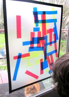 Colorful window art on contact paper from Mama's Little Muse