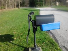 Save the newspaper receptacle, I LOVE this old-fashioned water pump mailbox--at a house down the road.
