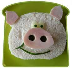 Pig Sandwich Art - Cut the bread in an oval shape.  Use lunch meat for the ears and lunch meat and olives for the snout.  The mouth is cucumber skin, the eyes are the white and skin of a cucumber.