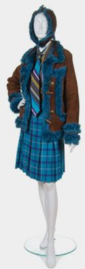 Anna Sui  (AMERICAN, b. 1964)  5 pieces: Coat, blouse with tie, skirt and hat; Brown suede hat with blue fur lining; Brown suede coat with blue fur lining, blue fur cuffs, toggle closure, pockets; Striped blouse with button closure, cuffs and matching tie; Plaid wool pleated skirt, unlined, blue chainmail sewn on top of waist facing.