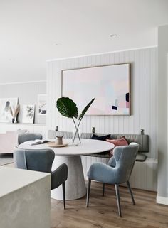 The norsuHOME - Dining Area Photographer: Lisa Cohen Stylist: Beck Simon  Paint: Dulux Tranquil Retreat Flooring: Godfrey Hirst  Benchtop: Caesarstone Panelling: EasyCraft  Products: GlobeWest Livorno Dining table, Daphne Velvet dining chairs, Tracey Mock Original art, Love Warriors Sky Circles print, Donna Delaney Matilda Print, Middle of Nowhere prints (all available at www.norsu.com.au)