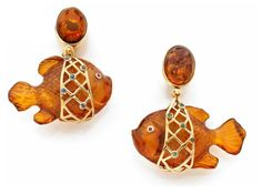 pair of earrings in yellow gold each adorned with a cabochon amber amber holding a fish carved natural belted a perforated panel cross set with sapphires and tourmalines. Segoura Eva Signed