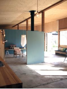 partitions! i wonder how high a ceiling needs to be for this to not look dumb. A Garage Turned Summer House in Sweden : Remodelista