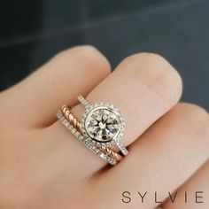 A bezel #engagementring setting is one of the best settings to have if you want extra protection for your center diamond! The stunning Anita ring features a bezel halo as well as a diamond halo creating a unique and show stopping look! #SYLVIE #SylvieCollection #BezelSet #bezelsetting #VintageRings #HaloEngagementRing #HaloRing #DiamondRing #WeddingRing #WeddingJewelry #WeddingSet See Less
