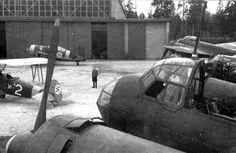 Finnish aircraft technician in a repair shop in Immola. Clockwise German…
