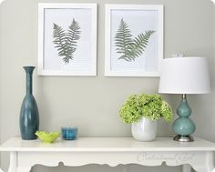 1) Gather ye fern fronds while ye may.  2)  Lay fronds between wax paper and press flat between large heavy books for 2-3 days.  3)  Lay flattened ferns on paper and affix to paper with a tiny bit of Mod Podge or craft glue, 4) display behind glass in frames.