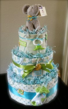 Surprise the new mommy with a fun and functional diaper cake. Includes diapers, three receiving blankets, socks, pacifier and stuffed animal. Three tier cakes start at $100 and can be completely customized. Email info@oliveparties.com.