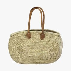 Our classic Casablanca Oval Market Tote is made from hand woven palm leaves with leather handles. Perfect as an everyday carryall.