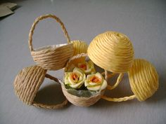 Use plastic Easter Eggs as 'molds' for miniature baskets. This is an easy way to make lots of baskets fast.
