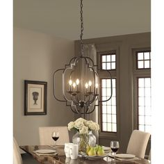 Illuminate your dining table or entryway with this contemporary yet classic 6-light chandelier. With a rich, dark bronze finish and Moroccan-inspired motif, this light is sure to become the focal poin