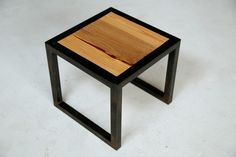 minimalist wood-panel-and-steel stools, benches and tables.