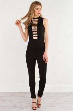 AKIRA Black Label Sleeveless Stretch Jumpsuit With Strap and Buckle Accents At Plunging Chest Cutout in Black
