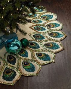 Loving this peacock embellished Christmas tree skirt for the perfect Christmas tree - NONAGON.style Whether you like your trees lavish and loud, or you're more of a minimal decorator, here are some great pointers for decorating your own Christmas tree. Peacock Christmas Tree, Blue Christmas, Winter Christmas, Christmas Holidays, Christmas Ornaments, Christmas Tree Skirts, Peacock Christmas Decorations, Christmas Photos, Crochet Christmas