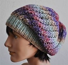 This fun, slouch hat glistens in sparkly Gold Rush. It is stylish and fun. It features ribbed edge with a eyelet rib design that tends (at least for me) to spiral slightly, which is a nice bonus effect.