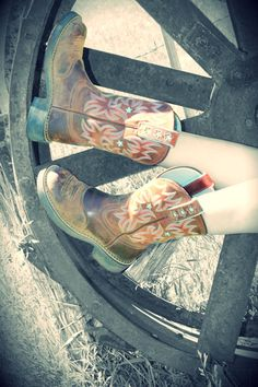 Boots and wagon wheel. Source: colouredandcolourless