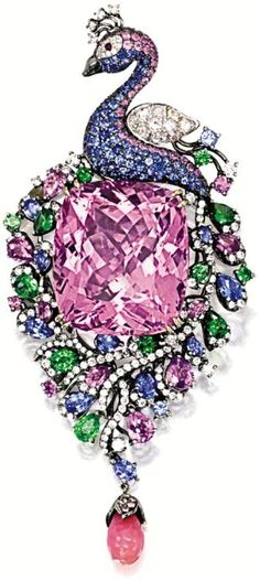 Kunzite, conch pearl, gem-set, and diamond peacock brooch/pendant.  The center kunzite is 46.10; the body is set with 8.40 carats of pear-shaped and circular-cut tsavorite garnets, sapphires, and pink sapphires; as well as 1.20 carats of diamonds. The brooch dangles a conch pearl, and the peacock's eye is a spinel. The gems are set in blackened gold. Via Diamonds in the Library.