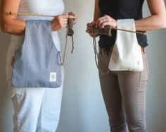 This listing is for 2 Knitting bags. (Medium Denim and small Linen)  This is the solution to the loose rolling yarn...  Save by buying two at a time... One for you and one for a friend.  The Medium one mesures 16.5 Tall X 11.5. Its made of Dark Denim and beige cotton on the other side. The smaller Bag mesures 12.5 Tall X 8. Its made of Beige Linen on one side and for the interior, I used denim but inside out, it gives an effect of gray. They are reversible...   Both bags are useful for a…