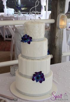 This past weekend we road tripped down to Cape May County to deliver this white on white, bling, musical themed wedding cake. The cake was finished off with beautiful, bright orchids. Congratulations to the couple!