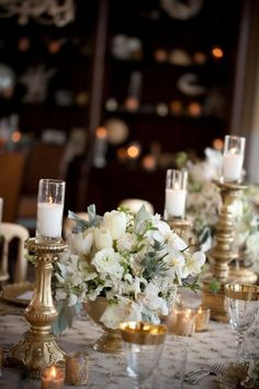 I'm envisioning a lush white low floral centerpiece with gold accents - via Elizabeth Anne Designs