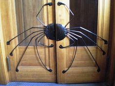 The itsy bitsy spider climbed up the wooden door ...