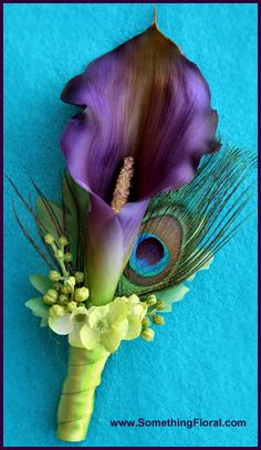 Ultra realistic, silk/artificial boutonniere featuring a purple mini calla lily, peacock feathers, green lilacs, and green berries. Design: Something Floral / Something Spectacular (Etsy store: SomethingFloral) Photo: Urban Fire Studio. Also available in other calla colors and color combinations, flower types, sizes, styles, and matching items (bouquets, corsages, etc). All designed to client specifications. #peacock #feather #boutonniere