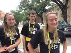 Hannah Holmes (left). Wyatt Whewell, and Heather Holmes, all of Lawrenceville, IL, walk down the street in Mobile, AL, on June 20, 2013, during the National Beta Convention in Mobile, AL. #beta