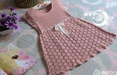 Crochet delicate dress for baby