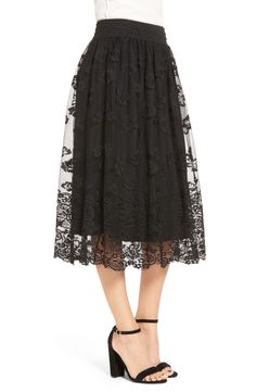 A scalloped floral-lace overlay brings a delicate, floaty look to this midi-length skirt topped with an ornately detailed waistband.