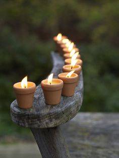 Candles in flower pots. I've used this idea on the deck during the summer months for many year now. Unbelievable how much light they throw off. Also, the ambience from the glow of candles is SUPER!