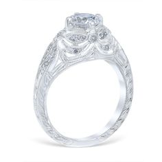 <p>Lincoln Drape engagement ring featuring a spectacular display of bead set diamonds, cascading filigree draperies, and subtle dragonfly detailing.</p> <p></p> <p>MSRP 14K: $3,715.00<br />MSRP 18K: $4,345.00<br />MSRP Plat: $5,175.00<br /><em>(Not including center diamond)</em></p> <p><br />Center Diamond Carat Range: 0.75-3.00ct.<br...