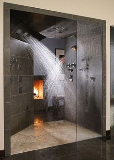 While fireplaces are traditionally found in dens, bedrooms and kitchens, a bathroom fireplace is the latest in cozy interior trends. Multiple shower heads give an all-over clean sure to make your mother proud.