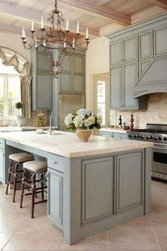 Beautiful Paint Color On The Cabinetry. I Love The Light Fixture And The  Design Of The Cabinetry. I Like This Kitchen!